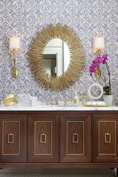 In the bathroom or powder room, consider replacing a traditional mirrored medicine cabinet with a large sunburst mirror for an unexpectedly elegant touch. Complement the mirror with a pair of wall sconces in a finish that matches the sunburst. Decor, Interior Decorating, Interior Design Tips, Interior, Home Decor, Amazing Bathrooms, Interior Design, Bathroom Design, Bathroom Mirror Design