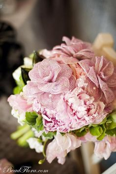 Pink romance French beaded flowers. a mix of fresh and fake flowers ;)