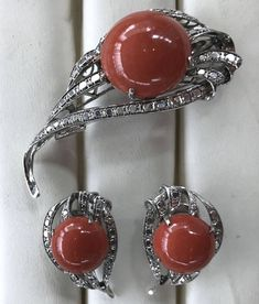 Gorgeous Vintage 14K White Gold Red Coral Earrings Brooch Pin Pendant Set Offered is a gorgeous vintage 14k white gold red coral earrings pin brooch pendant set. These amazing red coral jewelry set feature round shape red coral cabochon with 14k white gold diamond cut leaves