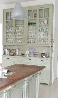 Love this piece that looks like an antique hutch! Love designing units like this out of stock cabinetry.
