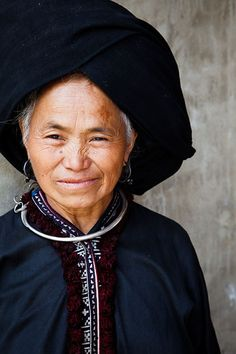 Vietnam | Portrait of a Black Dzao hill tribe woman wearing traditional clothing and headdress, located in Sin Ho market which is held every Sunday | © Kimberley Coole