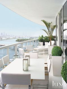Bisazza's white terrazzo glass floor continues onto the balcony, which is furnished with casual chairs, a dining table and inviting chaises, all by Sifas from Walters Wicker in New York. The pieces have a weather-resistant anodized-aluminum finish that makes them an ideal choice for the outdoor room.