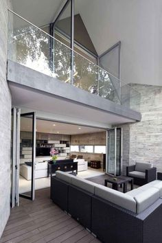 Love Love this space itself and all of the materials inside and out.  Would prefer dark frame doors/windows. - ccm