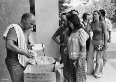 People who found shelter at the French Embassy in Phnom Penh are getting a meal late April 1975. On New Year's Day 1975, Communist troops led by Pol Pot and Ieng Sary, launched an offensive to oust Lon Nol's Khmer Republic. The Lon Nol governement in Phom Penh surrendered 17 April 1975 after 117 days of the hardest fighting of the war. Immediately after its victory, the PCK ordered the evacuation of all cities and towns. Many of the foreigners and some Cambodians, who couldn't or wouldn't…