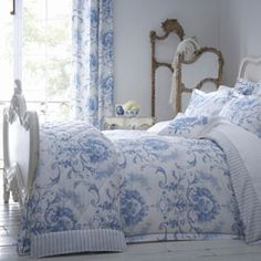 This duvet cover with a blue broad striped sheets underneath. Lush!
