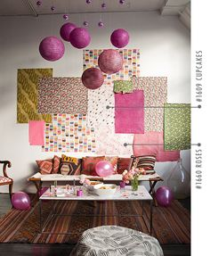 Large sheets of colorful wrapping paper hung on wall for a statement wall/decoration/backdrop.  spotted on Design Sponge | Snow and Graham