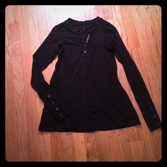 Lululemon long sleeve top 4 Nice black long sleeve top- cute for work or a jog ;) beautiful detail along front chest and  buttons on sleeves.  Absolutely stunning and no fading  lululemon athletica Tops