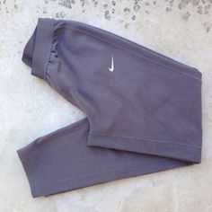 """Nike Therma-Fit gray fleece lined sweatpants So warm and comfortable! Fleece lined pants with elastic waist, zipper leg openings, and one side pocket on the back left. Inseam is 31"""", 100% polyester. Nike Pants Track Pants & Joggers"""