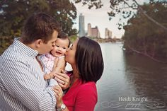 Austin, TX skyline Family Photos.  Ladybird Lake, Zilker Park.  Kissing their sweet baby girl.