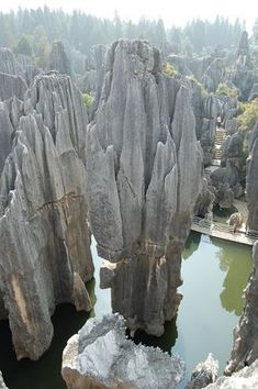 """The Yunnan Stone Forest. Arrayed across 96,000 acres is one of the world's most amazing geological formations. Despite what the name might suggest, these are not merely petrified trees. It is a region festooned with stone stalagmites, caves and other natural wonders that are unique to this Chinese land."""