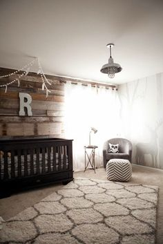Brown nursery for a little boy | A modern rustic outdoor inspired nursery with a…