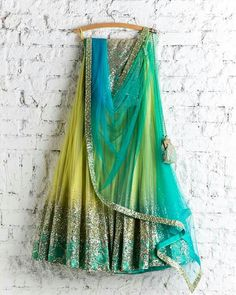 Buy this net yellow green lehenga choli with conscientious embroidery & lace work.This set is features a grey color blouse in silk fully embellished with foil booty work.It has matching yellow green lehenga in net with beautiful embroidery all over an Indian Lehenga, Indian Gowns, Indian Attire, Lehenga Choli, Pakistani Dresses, Rajasthani Lehenga, Western Lehenga, Net Lehenga, Anarkali
