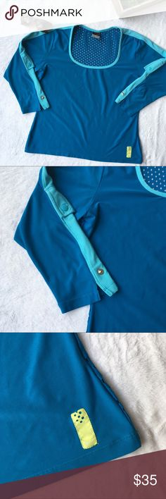 Nike Mesh netted ventilation back 3/4 sleeve top Cute and comfortable Women's Nike athletic top. Features ventilated netted mesh back and 3/4 sleeves. Sleeves are adjustable via the snaps and blue stripes down the sleeves give a sporty look! Great for your active life! Excellent condition, no flaws. Size Large. Nike Tops