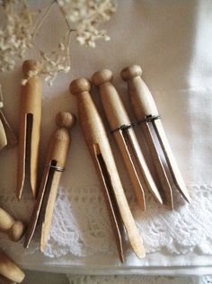 Antique clothes pins w/millinery flowers on lace... beautiful!