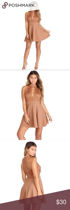 Brown Crochet Embellished Skater Dress  Make tonight a romantic affair in this awe worthy crochet dress! Dress features a sleeveless bodice, mock neck, plunging V neckline with floral crochet trim and a lined crochet lace bodice that leads to an empire waistband. The waist leads to a playful skater length crepe skirt that will keep you twirling the night away! Dress is composed of crochet knit and crepe fabric that offers a form fit with moderate stretch. Windsor Dresses Mini