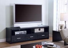Coaster Furniture Low Profile TV Stand with 3 Drawers. Solid wood construction with veneers. Black finish. 3 Drawers and 2 Open shelves. Maximum TV Size: 60 in. Maximum TV weight: 88 lbs.
