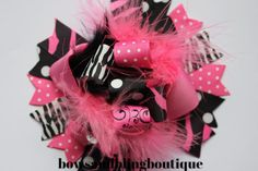 """I love this super cute pink and black funky hair bow! The bow is layered with vibrant colors and beautiful ribbon. Each bow pictured measures approximately 5""""-5.5"""" across. It is perfect for babies, to"""