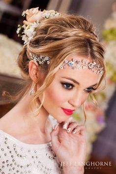 How gorgeous is this beautiful updo? The detailed head band makes it even more elegant.