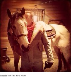 Bruce Springsteen kissing a horse.  You're welcome.