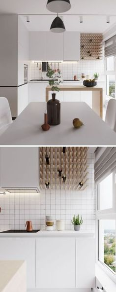 Wood pegs on the white walls are used for wine storage in this modern kitchen.
