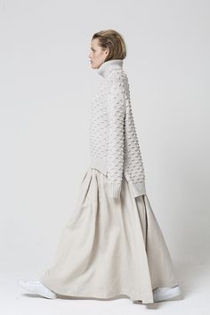 The Salasai Displaced Jumper is a classic knit jumper with a twist. The jumper features a unique polka dot texture, a high roll neckline and a split side hem dr
