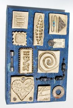 Assemblage with found objects and clay