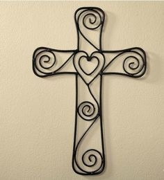 Wire Heart Cross from CurrentCatalog.com.  Intricate metal swirls entwine to form a heart within a heart at the center of this wire cross. Beautiful, inspiring gift for those close in friendship and faith.  Get your rebate from RebateBlast.