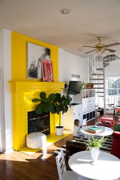 Bright yellow fireplace in a downstairs playroom