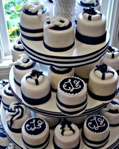 Nautical themed cupcakes #wedding #weddingcupcakes #nautical #cupcakes #cupcaketower