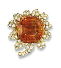 A CITRINE AND DIAMOND FLOWER BROOCH, BY CARTIER   The central octagonal-shaped citrine within a border of brilliant-cut diamond petals to the single-cut diamond line stem, circa 1965, 3.8 cm wide  Signed Cartier, No. 9048