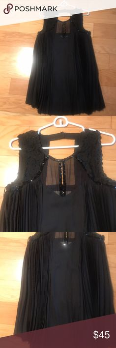 Don't wear Anthropologie dress that's perfection for holidays or the theatre in winter. It's a tent dress with embellished top, accordion pleats all around. Short and cute. Leifsdottir Dresses Mini