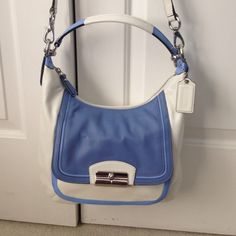 Authentic blue/white Coach crossbody and shoulder Authentic blue/white Coach crossbody and shoulder strap. Never been used. Has original care card in pocket. Gorgeous, perfect condition. Coach Bags Crossbody Bags