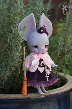 Batty Boo in her garden between her favorite flowers, lavender!  CCC Batty Boo, bat anthro BJD 14cm GID deep purple Tiny hat by WeeDollywears Marie Patterson Wizard piggy Outfit by Dollheart