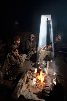 Kalash men warm themselves around a fire deep in the mountains of the Hindu Kush in Northern Pakistan bordering Afghanistan. The Kalash are a non-muslim tribe who practice an ancient religion photo by Steve McCurry Religions Du Monde, Cultures Du Monde, We Are The World, People Around The World, Around The Worlds, National Geographic, Steve Mccurry Photos, Kalash People, Rodney King