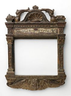 Carved, polychromed and gilded tabernacle frame with dolphin pediment and cherub antependium, originally integral with the work framed.