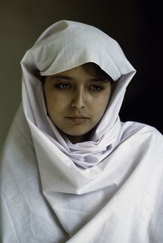 The face speaks pain, sorrow, resignation....Steve McCurry _ A young Afghan school girl in Kabul.