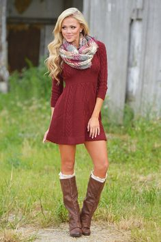 You have no doubt that they're going to love you, and they'll love you even more when you show up in this classy cable knit sweater dress! Pairs perfectly with