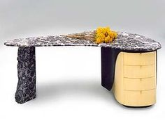 The Orbicule Unique Desk $0.00 The combination of raw stone with fine timber craftsmanship is what JahRoc Furniture is all about. It is where the name originated from JAH (jarrah) and ROC (stone). The Orbicule Desk is a classic example of how this combination works, using Orbicular granite together with Huon Pine and ebonised timber. Orbicular Granite is extremely rare to find and there are no working mines in the world at present. Currently (2013) JahRoc Furniture have a nice selection of