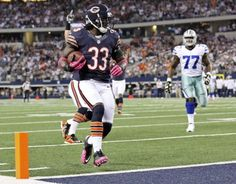 Charles Tillman wears pink gloves and cleats