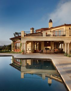 tile roof, iron balustrade, wood doors, pool