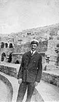 """One of the SKINNER's Chief Petty Officers tours ruins, probably in France or Spain, circa 1918-1919.  The original image is printed on post card (""""K Ltd"""") stock. Its reverse bears the hand-written comment: """"Chief Electrician on the Skinner""""."""