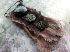 SALE Long Lost ~ antique glass button brooch ~ tattered shabby Victorian Grunge assemblage lace textile pin OOAK by EnchantressAdornment on Etsy https://www.etsy.com/listing/260293488/sale-long-lost-antique-glass-button