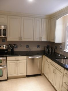 fabulous kitchen cabinet for traditional small kitchen  imposing glossy black countertop to combine with cream cabinet and brown tiled backs  image result for 405 cabinet price spartan white vs  venice creme      rh   pinterest com