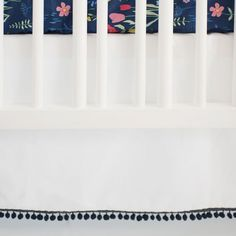 Our White Crib Skirt with Navy Pom Poms is fun and fresh! Our white crib skirt coordinates with our Poppyfield Crib Collection for a bright nursery!