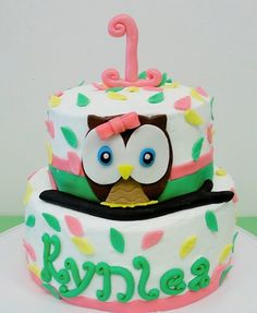 Look Whoo's One Owl Birthday Cake - I made this cake for my little girls first birthday. I only make about one or two cakes a year but I wanted to make one for her. The cake is buttercream with fondant accents. The owl is fondant and the number one, leafs, and her name are all fondant/gum paste. The letters are hand made, not cut outs.