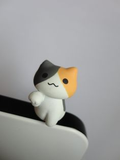 SALE 80-20%OFF: Cute Orange Cat Sitting // iPhone Plug . Phone Charm . Phone Plug . Dust Plug - Hand Painted, cat, Kawaii, Girly. $3.90, via Etsy.