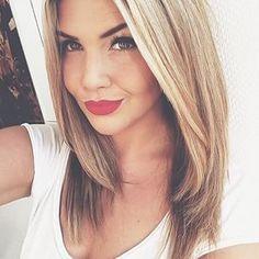 Medium length blonde hair.