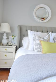 A gray, white, and calming master bedroom retreat by DIY Playbook.