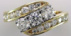 3 stone diamond ring with channel set diamonds