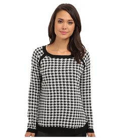 Jack by BB Dakota Nolan Sweater Black/White - SKU 8418126.  Polished perfection. Chic houndstooth sweater features solid black trim for a captivating style. Boat neckline and long sleeves. Pull-on design flaunts a relaxed fit. Ribbed-knit trim. Curved hemline. 100% acrylic.